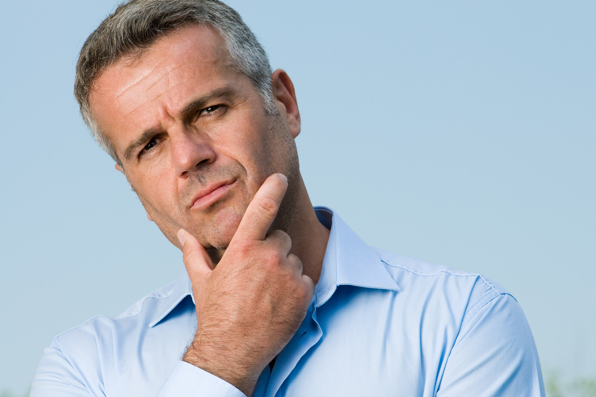 Man Posing With Contemplative and Doubtful Expression on His Face