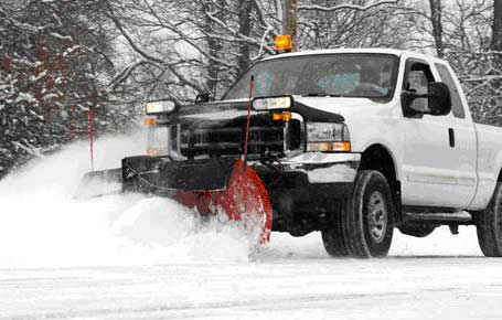 White Pickup Truck Working As Snow Pllow